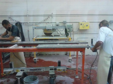 Granite fabricators making a custom countertop